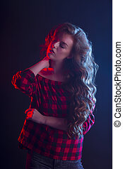 Sensual woman with long hair and red light