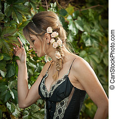 Sensual woman with roses in hair - Beautiful sensual woman...