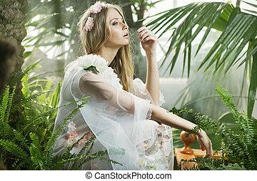 Sensual young lady among the greenery - Sensual young woman...