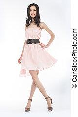 Sensual young woman in trendy dress posing
