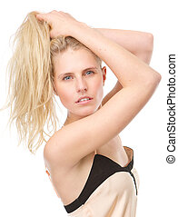 Sensual young woman posing with hands in hair