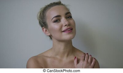 Sensual young woman touching skin - Attractive young woman...