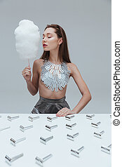 Sensual young woman with coton candy and vintage razor ...