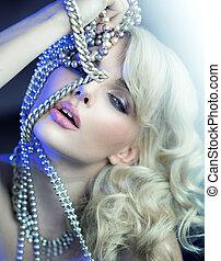 Sensual young woman witrh silver jewelary