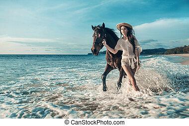 sensuale, brunetta, donna camminando, con, uno, maestoso, cavallo