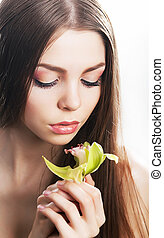 Sensuality - beautiful female with flower, fresh orchid - ...