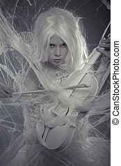 Sensuality beautiful woman trapped in a spider web with a white violin, lace dress