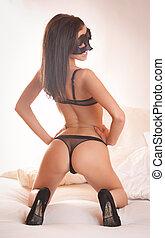 Sensuality - Very sexy brunette posing in stylish black...