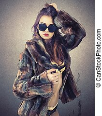 Sensuality woman - Beautiful woman in fur shows her...