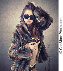 Sensuality woman - Beautiful woman in fur shows her...