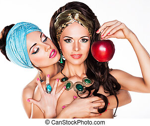 Sensuality. Women Hugging and Holding Red Apple