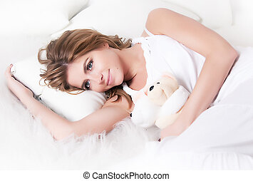 Sensuality - young dreamy female with soft toy - bruin