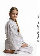 sentando, chão, judo, vista, menina, lado, classe