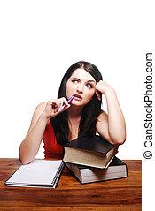 sentando, confundido, bloco escrevendo, escrivaninha, menina