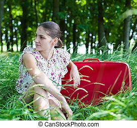sentando, mulher, mala