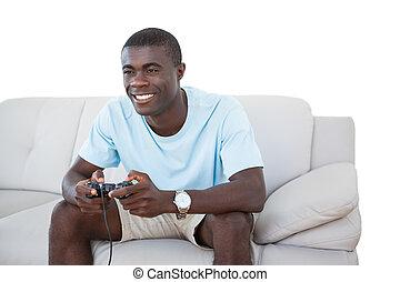 sentando, sofá, jogos, vídeo, sorrindo, tocando, homem