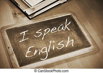 sentence I speak english written with chalk on a blackboard,...