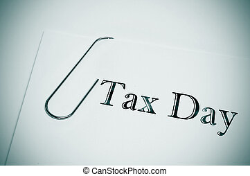 tax day - sentence tax day written in the cover of a dossier