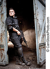 Sentinel - Brave sentinel with M4 carbine near the rusty...