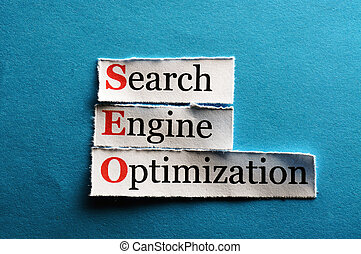 Conceptual SEO acronym on blue - Search Engine Optimization