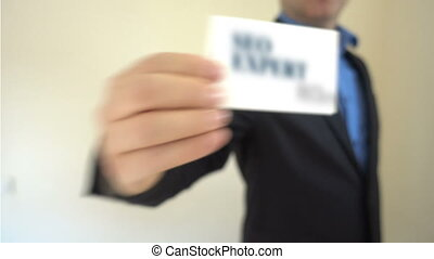 SEO Expert with Business card - Shot of SEO Expert with...