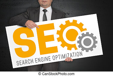 SEO poster is held by businessman