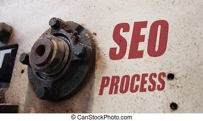 SEO process conceptual metaphor - Machine wheels rotating...