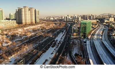 Seoul City 102 - 102) Time lapse of traffic and architecture...