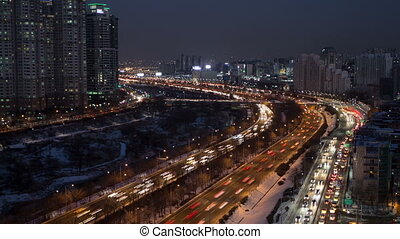 110) Time lapse of traffic and architecture in Yeouido. Seoul, Korea.