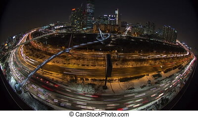Seoul City 120 - 120) Time lapse of traffic and architecture...
