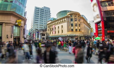 194) Zooming time lapse of large crowds of people shopping and walking around in Myeong-dong, Seoul.