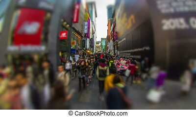 196) Time lapse of large crowds of people shopping and walking around in Myeong-dong, Seoul.
