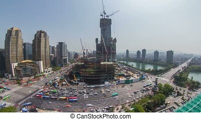 221) Time lapse in Jamsil of a huge construction site and traffic. Seoul, Korea.
