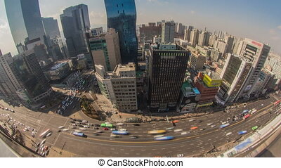 Time lapse of traffic and architecture in downtown Seoul.