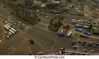 Seoul City Zoom 56 - 56) Zooming time lapse of traffic and...