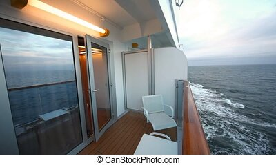 separate balcony of cabin of ship with chairs and little...