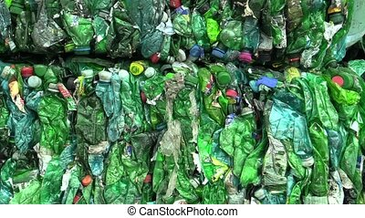 Separated and pressed waste green plastic bottles package...