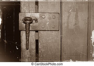 Sepia Antique Lock on Wooden Door - A horizontal image of a...