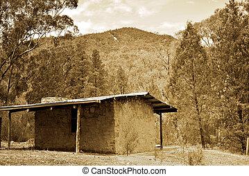 sepia bush hut