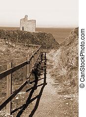 sepia fenced path to Ballybunion beach