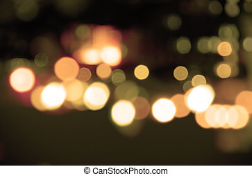 Sepia lights - Abstract background of blurred street lights...