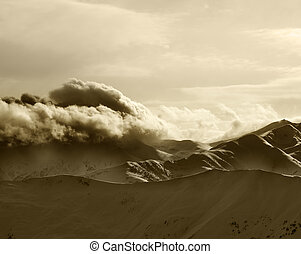 Sepia mountains in haze at sunny evening