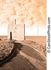 sepia path to ballybunions old castle ruins