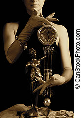 Sepia picture of a clock and beautiful young girl (focus on clock)