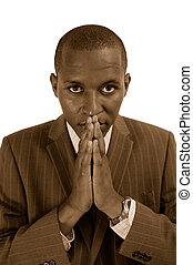 Sepia - Prayerful Man - This is an image of a businessman,...