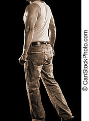 sepia sexy male in jeans isolated on a black background.