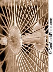 Sepia Spokes - Old antique bicycle spokes in sepia tone. I...
