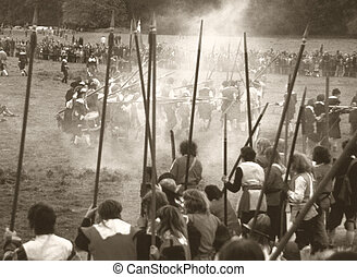 Sepia tone image of re-enactment of English Civil War battle, with visible film grain for dramatic effect