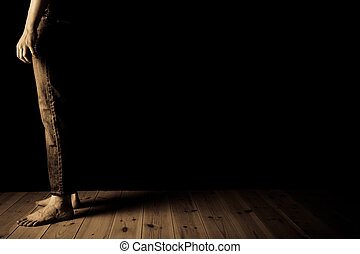 Sepia toned image of teenage boy standing