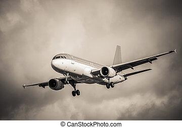 turbulence - sepia toned passenger aircraft landing in ...
